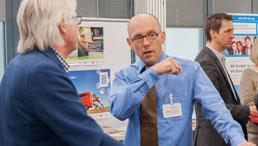 Stephan Plichta udn Christoph Harnischmacher bei einer Veranstaltung im Gespräch.